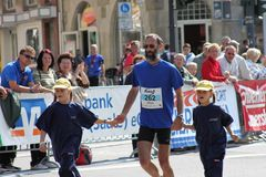 Father and his two daughters at Halle Marathon Royalty Free Stock Photography
