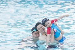 Father and his two son play in the water stock photos