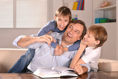 Father and his two sons  at home Royalty Free Stock Images