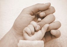Father hold baby hand Royalty Free Stock Photo