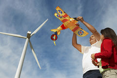 Father Holding Airplane Kite With Daughter Stock Photos