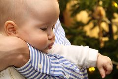 Father holding baby. In her arms Royalty Free Stock Photos