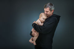 Father holding a baby Stock Image