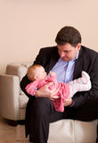 Father holding baby girl Stock Photography