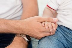 Father holding child's hand Royalty Free Stock Images