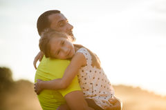 Father holding cute girl child in his arms. Affection and love. Royalty Free Stock Images