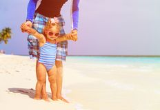 Father holding cute little daughter on the beach Royalty Free Stock Image