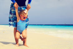 Father holding cute little daughter on beach Royalty Free Stock Photo