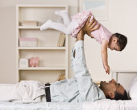 Father Holding Daughter Stock Images