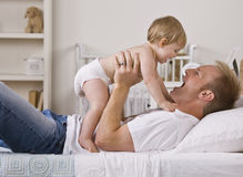 Father Holding Daughter Royalty Free Stock Photo