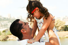 Father holding daughter Royalty Free Stock Photos