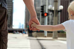 Father holding  the daughter/ child  hand  behind  the traffic lights Royalty Free Stock Photography