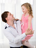 Father holding daughter and they dancing Royalty Free Stock Image