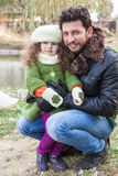 Father is holding daughter outdoors Royalty Free Stock Images