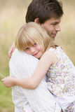 Father holding daughter outdoors smiling Royalty Free Stock Photos