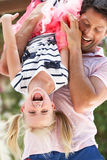 Father Holding Daughter Upside Down Outdoors Royalty Free Stock Photo