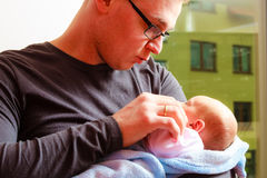 Father holding delicate his newborn baby. Stock Photo