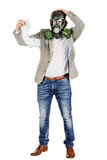 Father holding dirty dirty diaper in one hand fingers with gas m. Young father holding dirty dirty diaper in one hand fingers with gas mask over white background Stock Photos