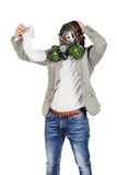 Father holding dirty dirty diaper in one hand fingers with gas m. Young father holding dirty dirty diaper in one hand fingers with gas mask over white background Royalty Free Stock Images