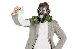 Father holding dirty dirty diaper in one hand fingers with gas m. Young father holding dirty dirty diaper in one hand fingers with gas mask over white background royalty free stock photography