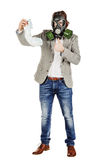 Father holding dirty dirty diaper in one hand fingers with gas m. Young father holding dirty dirty diaper in one hand fingers with gas mask over white background Stock Photography