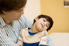 Father holding disabled son at hospital Royalty Free Stock Image