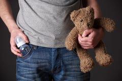 Father Holding Feeding Bottle And Teddy Bear Stock Photos