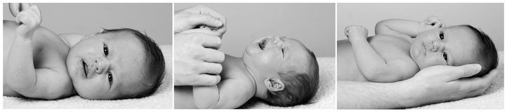 Father is holding fingers of baby boy Royalty Free Stock Image