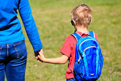 Father holding hand of little son with backpack. Outdoors, back to school Royalty Free Stock Images