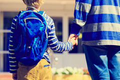 Father holding hand of son on going to school. Or daycare Royalty Free Stock Photo