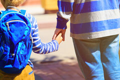 Father holding hand of son on going to school or daycare. Father holding hand of little son on going to school or daycare Royalty Free Stock Photos
