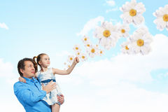 Father holding on hands daughter royalty free stock photos