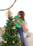 Father holding her daughter for the christmas tree Royalty Free Stock Photo