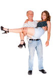 Father holding her daughter, indoors stock photo