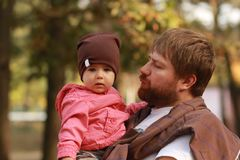 Father holding her little daughter in the park Stock Images