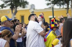 Father holding his baby daughter at protest against Nicolas Maduro stock photos