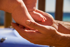 A father holding his baby's feet Royalty Free Stock Images