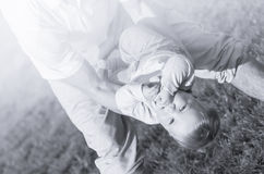 Father holding his baby son upside down Royalty Free Stock Image