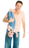 Father holding his baby upside down Royalty Free Stock Photography