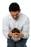 Father holding his child Stock Photos
