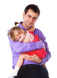 A father is holding his daughter Stock Image