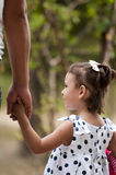 Father holding his daughter hand Stock Photos