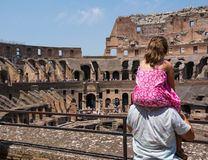 Father is holding his daughter on his shoulders to see the inside arena of Coliseum Royalty Free Stock Photo