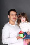Father holding his daughter Stock Image