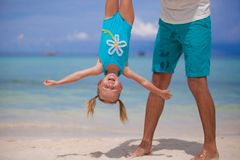Father holding his happy smiling daughter upside Stock Images