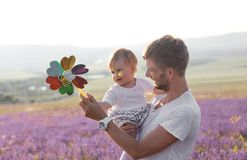 Father holding his little cute daughter. stock images