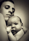Father holding his newborn baby in his arms Stock Image