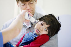 Father holding his sick disabled son at hospital Royalty Free Stock Image