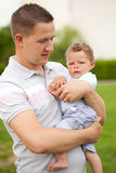 Father holding his son Royalty Free Stock Images