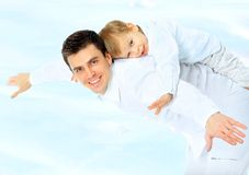 Father holding his son. Adorable affection arms attractive beach beautiful boy caucasian child cloud cute dad Royalty Free Stock Image